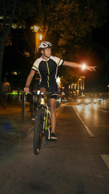 Cyclists with Useeme Bike Turn Signals doing a hand signal